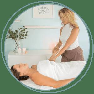 Kathryn Winget massaging a patients arm