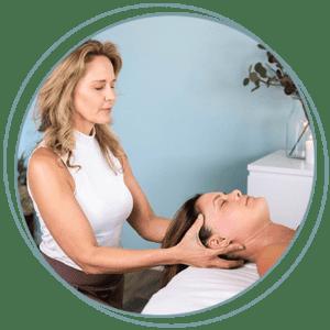 Kathryn Winget massaging a patients head